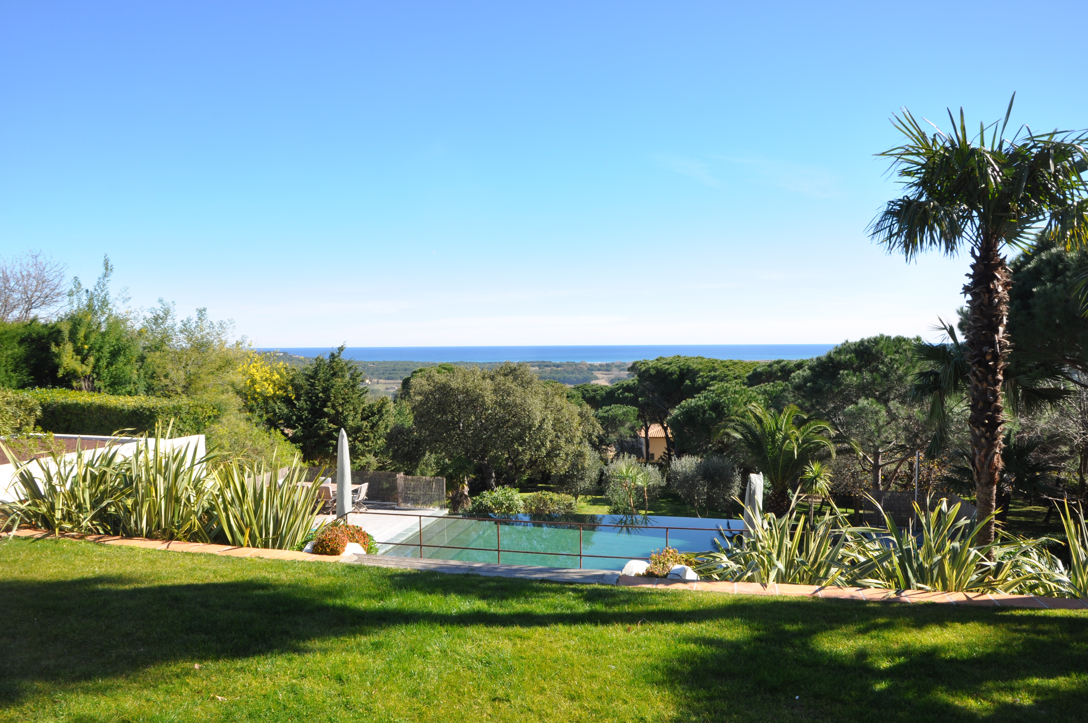 Views of swimming pool, gardens and sea