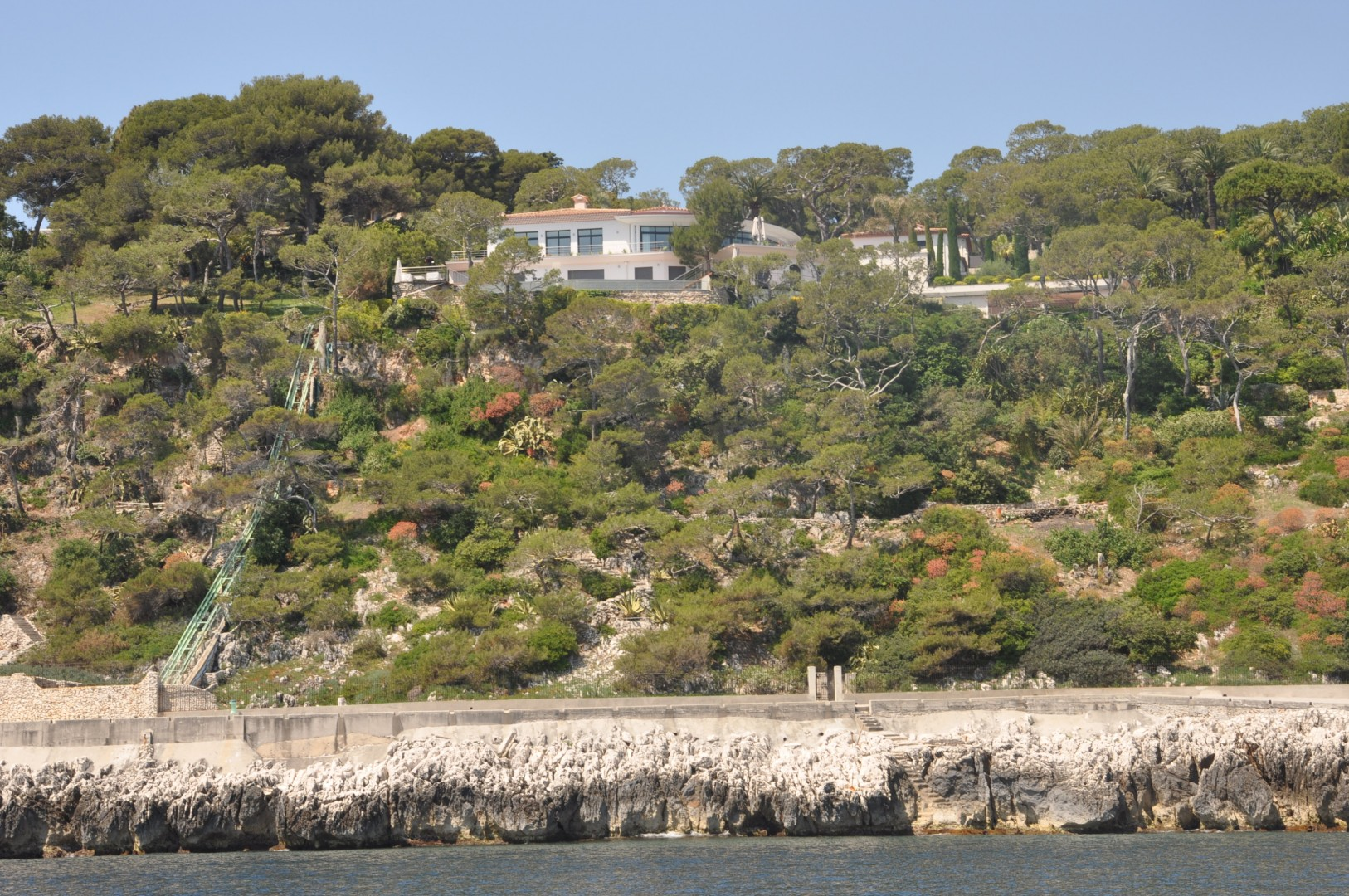 Cap Ferrat Real Estate view from the sea of a villa