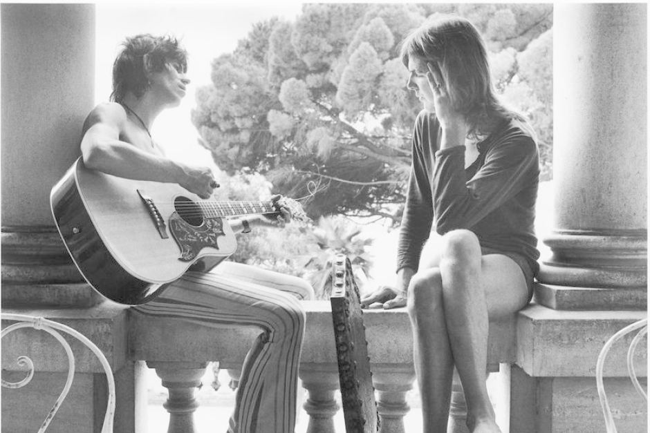 playing the guitar on the terrace