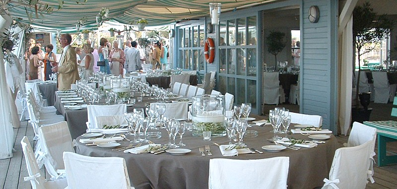 Tables set for a wedding at la plage des jumeaux